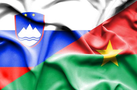 burkina faso: Waving flag of Burkina Faso and Slovenia