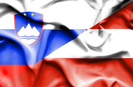 Waving flag of Austria and Slovenia Stock Photo