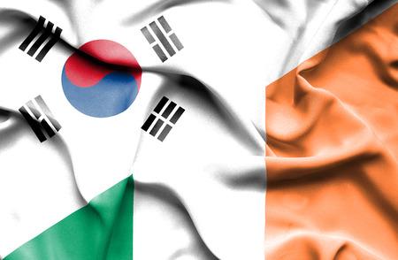 irish history: Waving flag of Ireland and South Korea Stock Photo