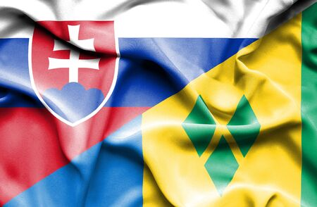 grenadines: Waving flag of Saint Vincent and Grenadines and Slovak Stock Photo