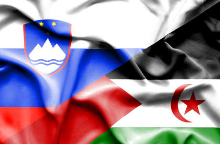 slovenia: Waving flag of Western Sahara and Slovenia Stock Photo