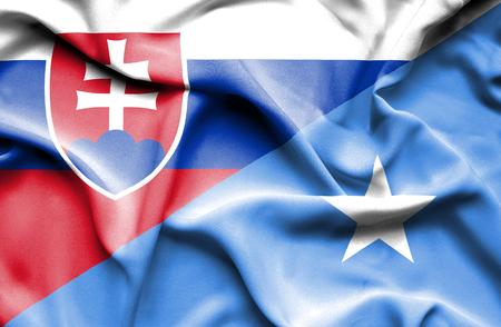 slovak: Waving flag of Somalia and Slovak Stock Photo