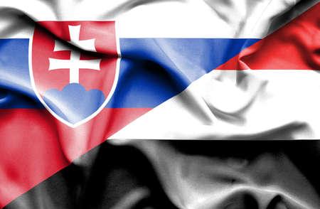slovak: Waving flag of Yemen and Slovak Stock Photo