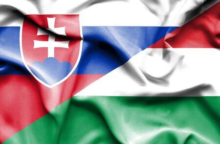 slovak: Waving flag of Hungary and Slovak Stock Photo