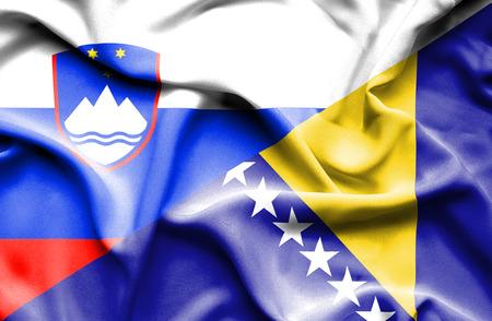 bosnian: Waving flag of Bosnia and Herzegovina and Slovenia Stock Photo