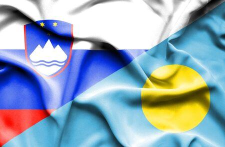 palau: Waving flag of Palau and Slovenia