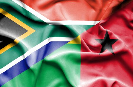 guinea bissau: Waving flag of Guinea Bissau and South Africa Stock Photo