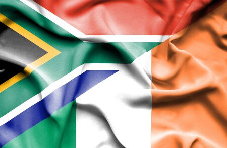 irish history: Waving flag of Ireland and South Africa Stock Photo