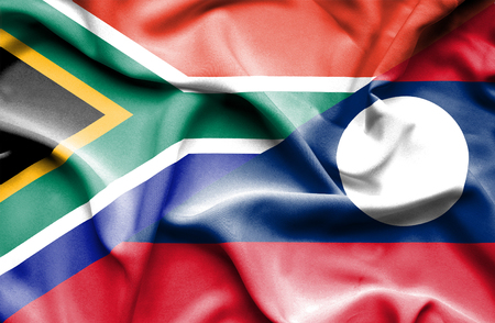 laos: Waving flag of Laos and South Africa