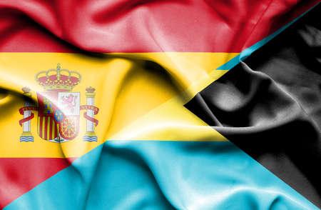 bahamas: Waving flag of Bahamas and Spain Stock Photo