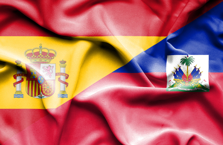 haiti: Waving flag of Haiti and Spain Stock Photo
