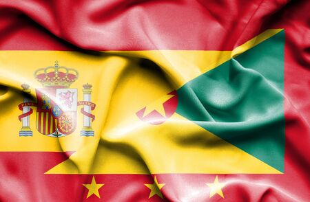 guernsey: Waving flag of Guernsey and flag, Spain Stock Photo