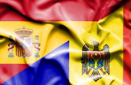 moldavia: Waving flag of Moldavia and Spain Stock Photo
