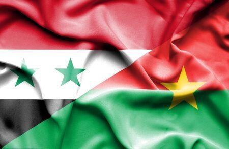 burkina faso: Waving flag of Burkina Faso and Syria
