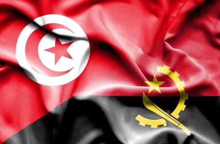 tunisia: Waving flag of Angola and Tunisia Stock Photo