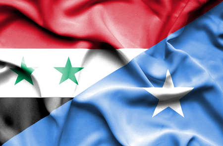 somalian culture: Waving flag of Somalia and Syria Stock Photo