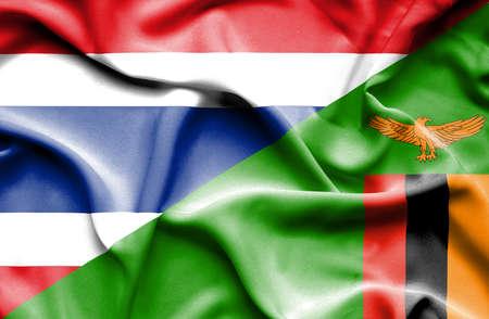 zimbabwe: Waving flag of Zimbabwe and Thailand Foto de archivo