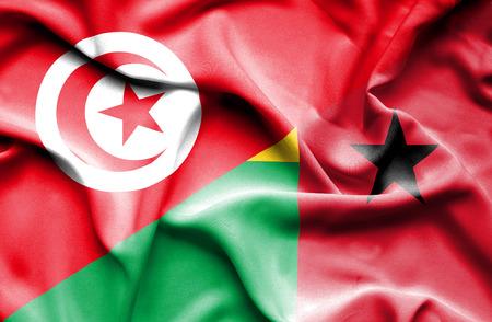 guinea bissau: Waving flag of Guinea Bissau and Tunisia