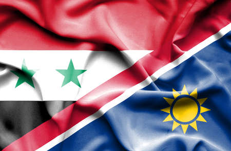 syria peace: Waving flag of Namibia and Syria Stock Photo