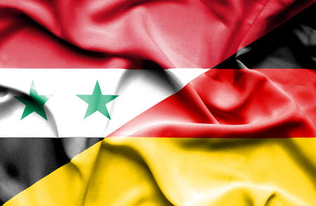 syria: Waving flag of Germany and Syria Stock Photo