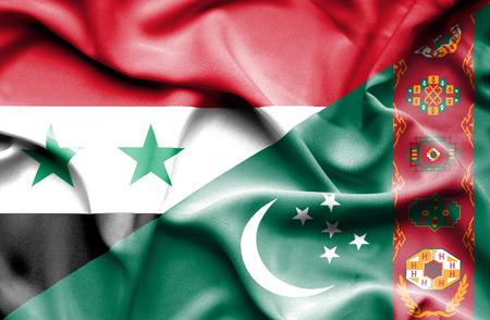 syria: Waving flag of Turkmenistan and Syria Stock Photo