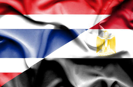 Waving flag of Egypt and  Thailand