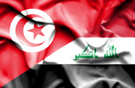 iraq conflict: Waving flag of Iraq and Tunisia Stock Photo