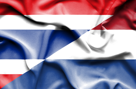 dutch culture: Waving flag of Netherlands and Thailand