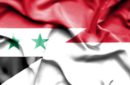syria peace: Waving flag of Indonesia and Syria Stock Photo