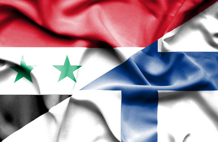 syria peace: Waving flag of Finland and Syria Stock Photo