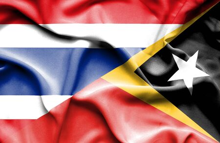 east: Waving flag of East Timor and Thailand