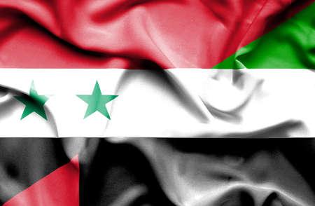 syria peace: Waving flag of United Arab Emirates and Syria