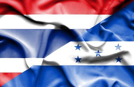 honduras: Waving flag of Honduras and Thailand Stock Photo