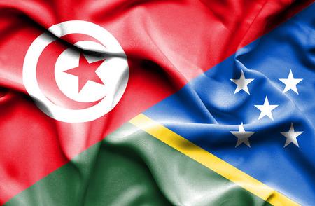 tunisia: Waving flag of Solomon Islands and Tunisia Stock Photo