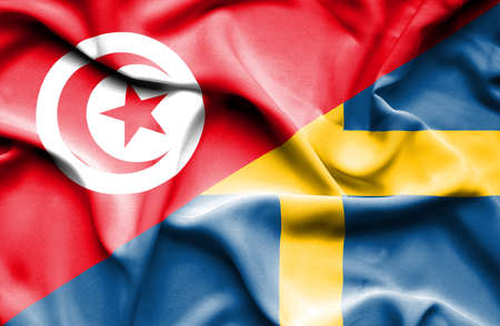 tunisia: Waving flag of Sweden and Tunisia Stock Photo