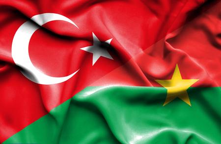burkina faso: Waving flag of Burkina Faso and Stock Photo