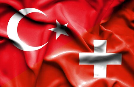 turkish flag: Waving flag of Switzerland and Stock Photo