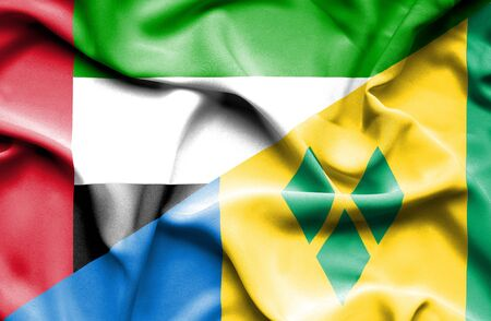 grenadines: Waving flag of Saint Vincent and Grenadines and United Arab Emirates Stock Photo