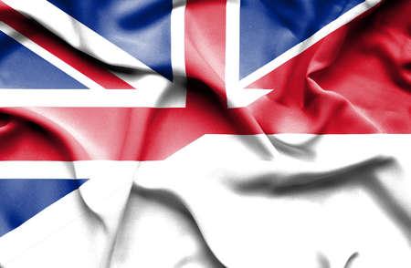 great britain: Waving flag of Monaco and Great Britain Stock Photo