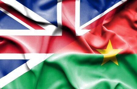 britain: Waving flag of Burkina Faso and Great Britain