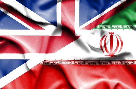 great britain: Waving flag of Iran and Great Britain Stock Photo