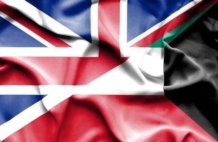 britain: Waving flag of Kuwait and Great Britain Stock Photo