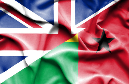 great britain: Waving flag of Guinea Bissau and Great Britain Stock Photo