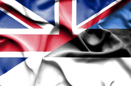 britain: Waving flag of Estonia and Great Britain Stock Photo