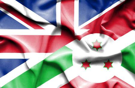 britain: Waving flag of Burundi and Great Britain Stock Photo
