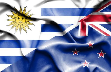 bandera de nueva zelanda: Waving flag of New Zealand and Uruguay Foto de archivo