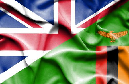 britain: Waving flag of Zimbabwe and Great Britain Stock Photo