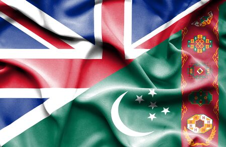 turkmenistan: Waving flag of Turkmenistan and Great Britain Stock Photo