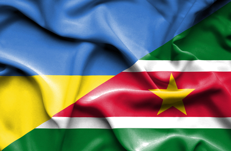 suriname: Waving flag of Suriname and Ukraine
