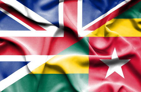 togo: Waving flag of Togo and Great Britain